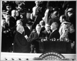 [Chief Justice Charles Evans Hughes administering the oath of office to Franklin Delano Roosevelt on the east portico of the U.S. Capitol, January 20, 1941]