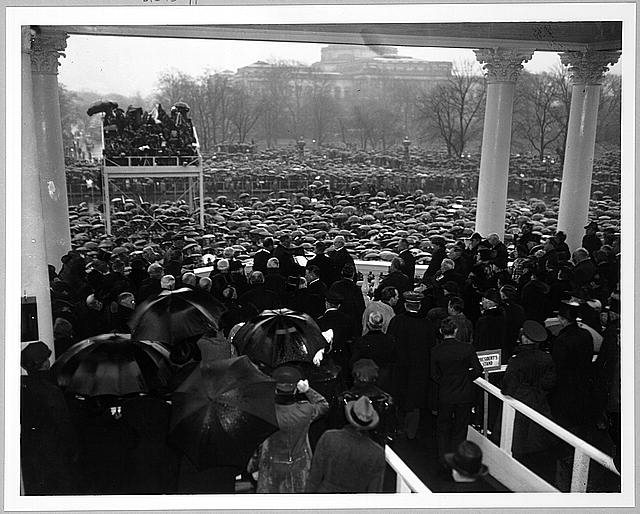 [Chief Justice Charles Evans Hughes administering the oath of office to Franklin Delano Roosevelt on the east portico of the U.S. Capitol, January 20, 1937]