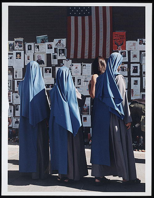 [Three nuns viewing a wall covered with missing notices after the September 11th terrorist attack on the World Trade Center, New York City]