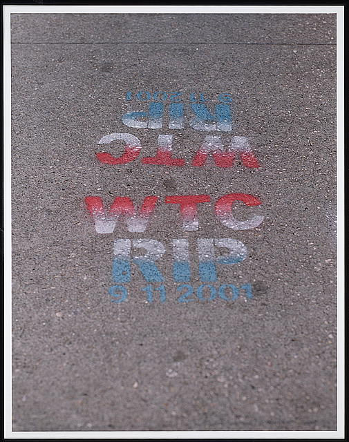"[Graffiti ""WTC, RIP, 9 11 2001"" on a sidewalk in response to the September 11th terrorist attack on the World Trade Center, New York City]"