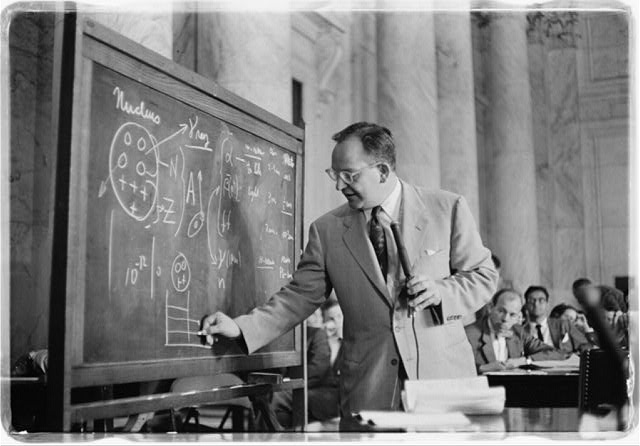 [Dr. Mark Mills drawing diagrams on a blackboard during testimony before the Congressional Joint Atomic Energy Committee hearings on atomic radioactive fallout]