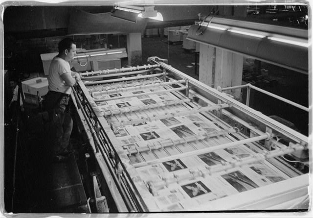 [U.S. News & World Report employee working on producing an issue of the magazine at the presses and plate making room in the production plant, Dayton, Ohio]