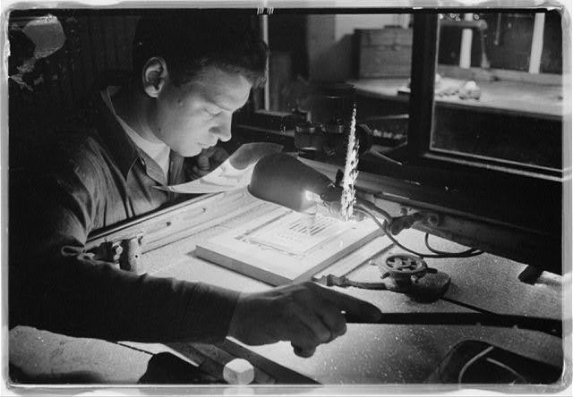 [U.S. News & World Report employee working on producing an issue of the magazine at the layout and paste-up room in the production plant, Dayton, Ohio]