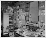 [Interior of L.C. Handy Studio, 494 Maryland Ave., SW, Washington, D.C., with glass negatives dating back to Mathew Brady piled on a table and in wood boxes lining a wall]