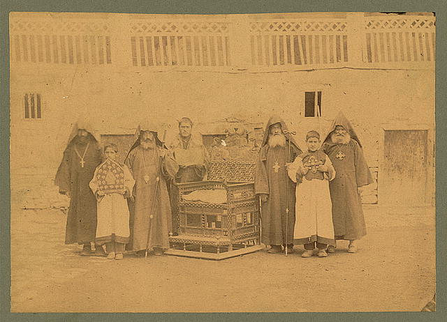 [Armenian monks and boys with throne of King Senekerim-Hovhannes of Vaspurakan, at Varagavank Monastery, Van, Turkey]