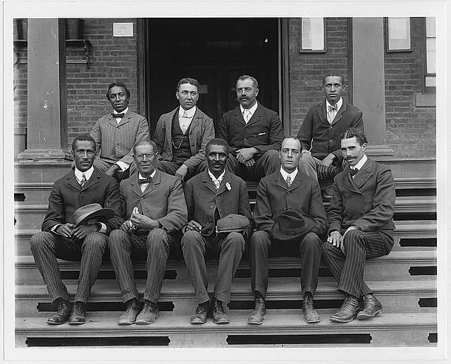[George Washington Carver, full-length portrait, seated on steps, facing front, with staff]
