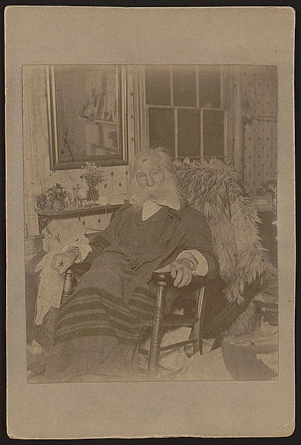 [Walt Whitman, as an elderly man, full-length portrait, seated in rocking chair, facing front]