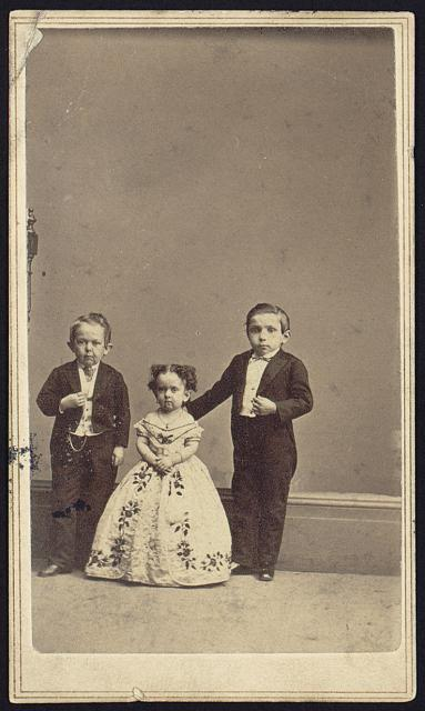 [Unidentified little people, two males and a female, full-length studio portrait, standing, facing front]