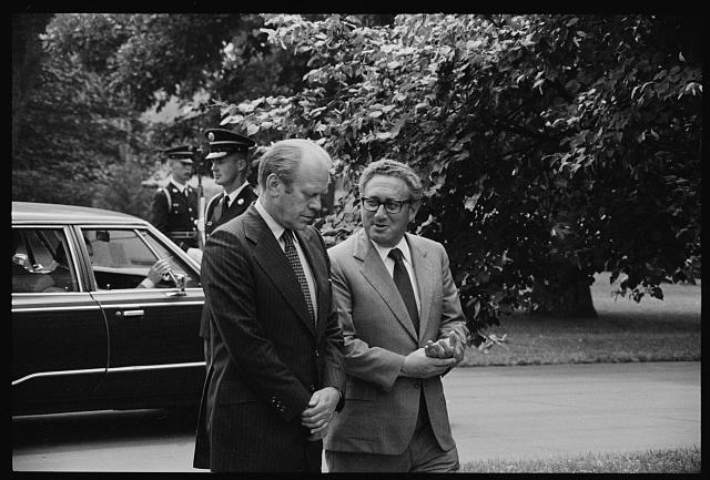 [President Gerald Ford and Secretary of State Henry Kissinger, conversing, on the grounds of the White House, Washington, D.C.]