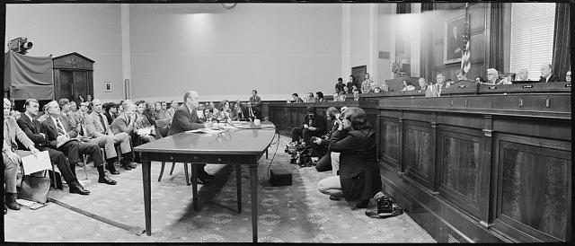 [President Gerald Ford being photographed while appearing at the House Judiciary Subcommittee hearing on pardoning former President Richard Nixon, Washington, D.C.]