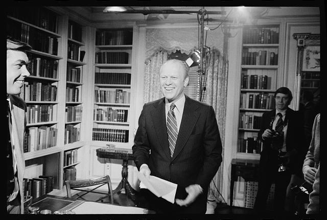 [President Gerald Ford standing and smiling after giving a television speech at the White House, Washington, D.C.]