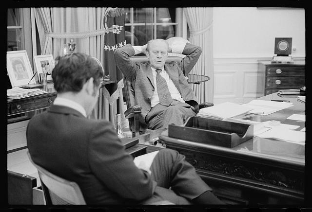[President Gerald Ford talking with aide John Mashek, at the White House, Washington, D.C.]