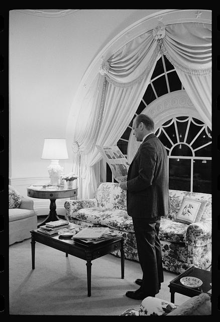 [President Gerald Ford reading the newspaper in the living quarters of the White House, Washington, D.C.]