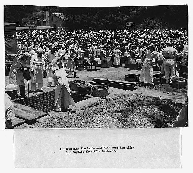 Removing the barbecued beef from the pits, Los Angeles Sheriff's Barbecue