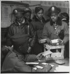"[Black fighter pilot series: ""Escape kits"" (cyanide) being distributed to fighter pilots at air base in southern Italy, 1945]"