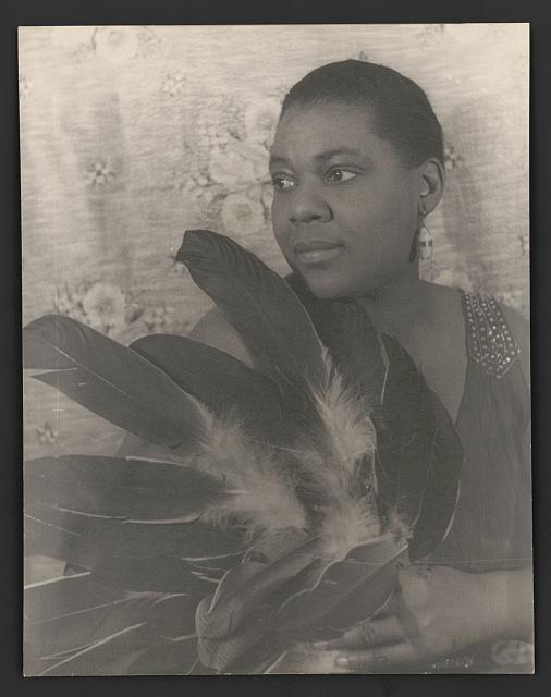 [Portrait of Bessie Smith holding feathers]