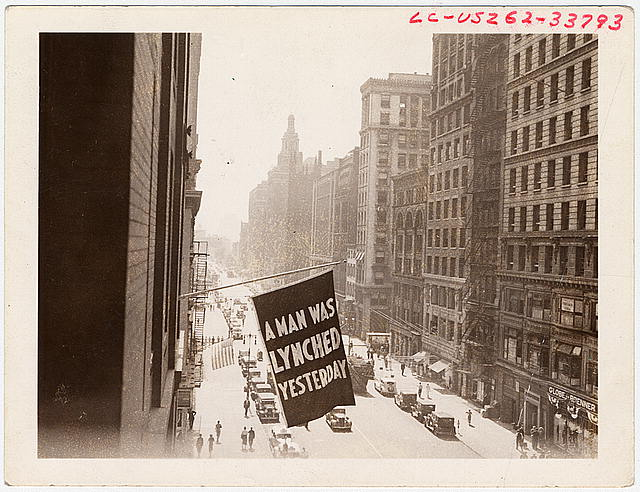 [Flag, announcing lynching, flown from the window of the NAACP headquarters on 69 Fifth Ave., New York City]