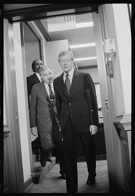 [President Jimmy Carter walks with members of the Three Mile Island Commission]