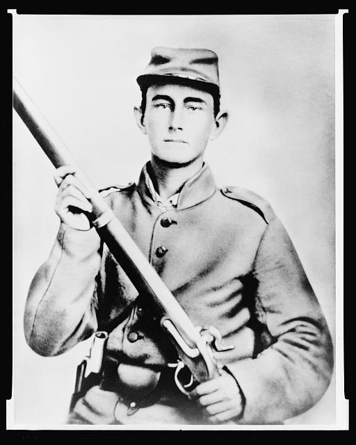 [Enoch Hooper Cook, Jr., Pvt, Co. H. 38th Alabama Infantry, C.S.A., half-length portrait, facing front holding rifle]