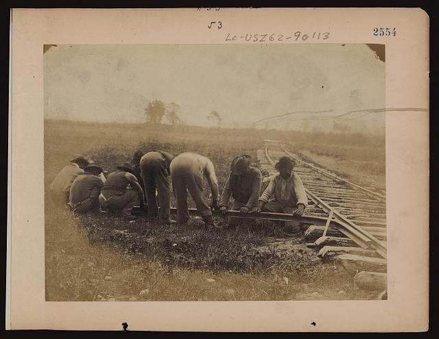 [Military railroad operations in northern Virginia: African American laborers twisting rail]