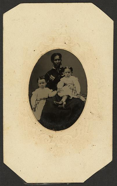 [Two children with an African American woman]