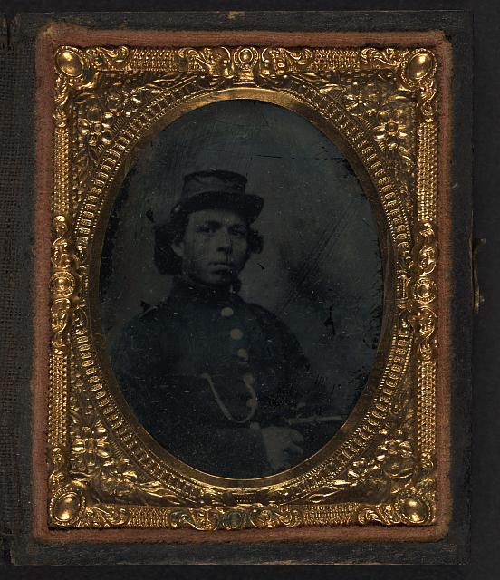 [Black soldier seated with pistol in hand, watch chain in pocket]