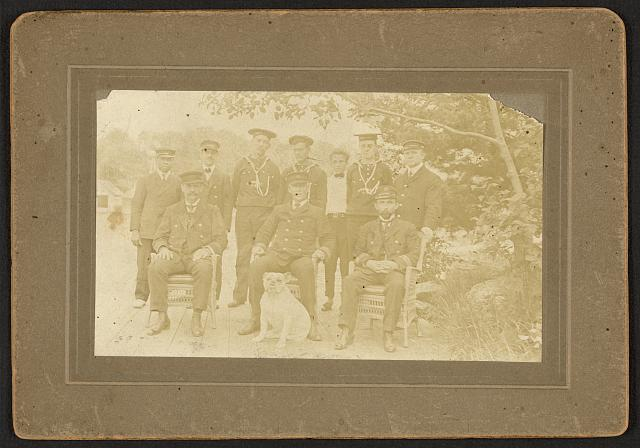 [Group portrait of naval personnel including an African American hospital steward]