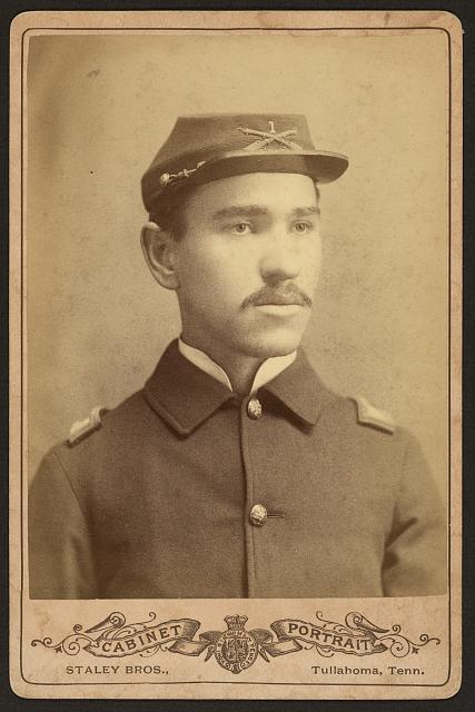 "[Buffalo soldier, African American officer, Lt. 1st Infantry, four button sack with crossed rifles and ""1"" on kepi]"