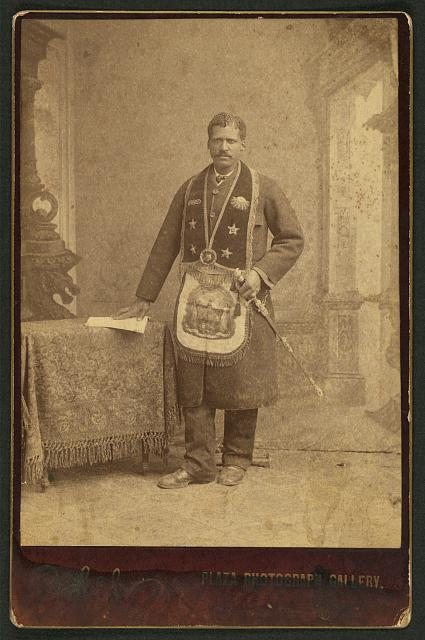 [African American man wearing fraternal order collar and apron]
