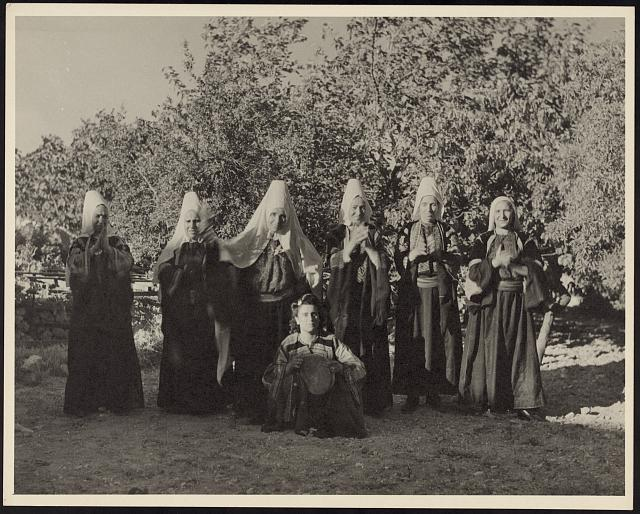 [A scene from a reenactment of the biblical story of Ruth the Moabitess, showing  Bethlehem women in traditional headdresses dancing at a wedding]