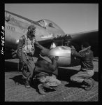 "[Edward C. Gleed and two unidentifiedTuskegee airmen, at air base at Ramitelli, Italy], ""adjusting extra gas tank"""