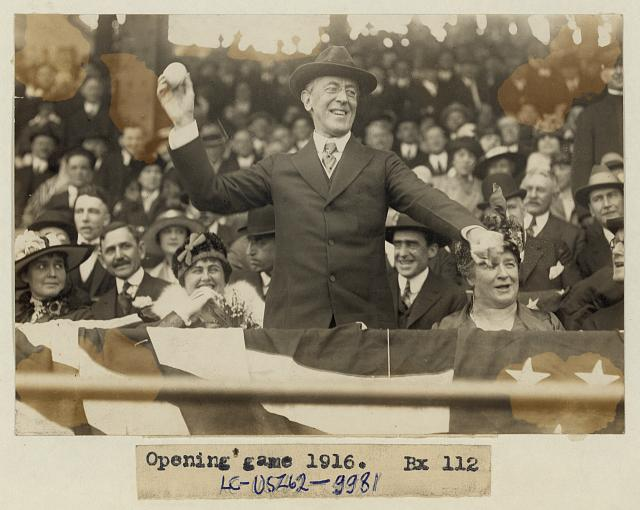 [President Woodrow Wilson throwing out the first ball, opening day, 1916; among those present are Edith Bolling Galt Wilson and Mrs. John A. (Ida) Wilson]