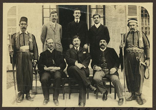 [Group portrait of Mr. Clark, Mr. Coffin, Mr. Galat, Sr.; John Whiting, Mr. Heck, and Mr. Galat, Jr., possibly at American Consulate, Jerusalem]