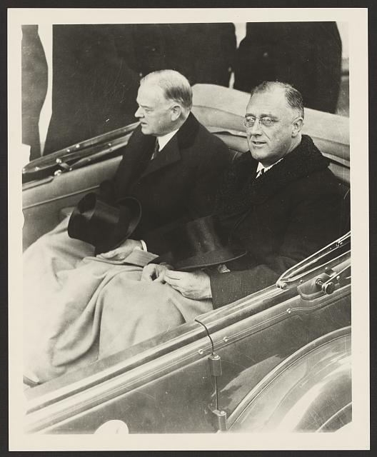 [Franklin Delano Roosevelt and Herbert Hoover in convertible automobile on way to U.S. Capitol for Roosevelt's inauguration, March 4, 1933]
