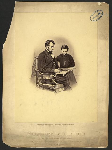 President A. Lincoln reading the Bible to his son