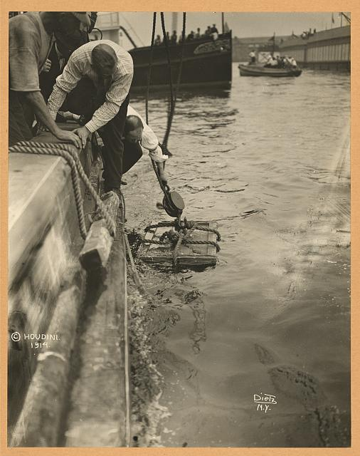 [Crate containing Harry Houdini lowered into New York Harbor, July 7, 1912]