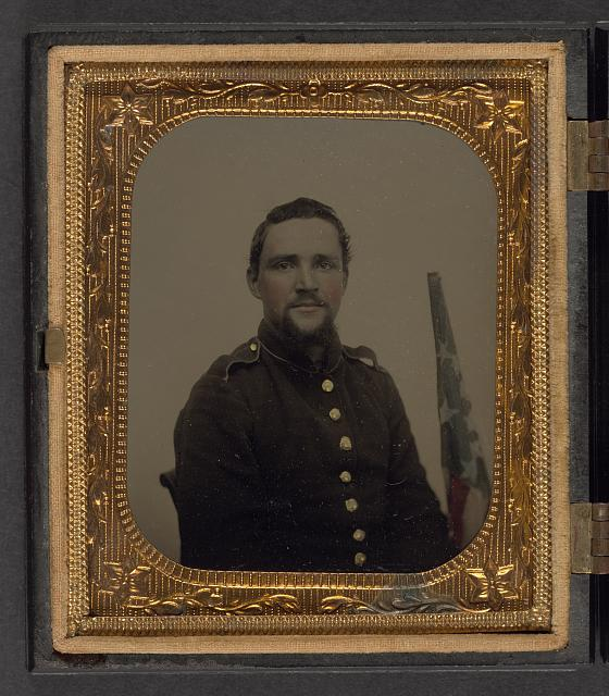 [Unidentified soldier in Union New York style shell jacket with American flag]
