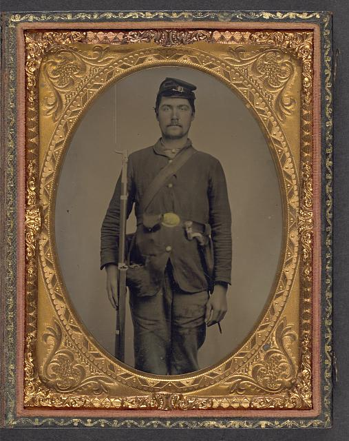 [Unidentified soldier in Union uniform with bayoneted musket, bayonet in scabbard, and cap box]