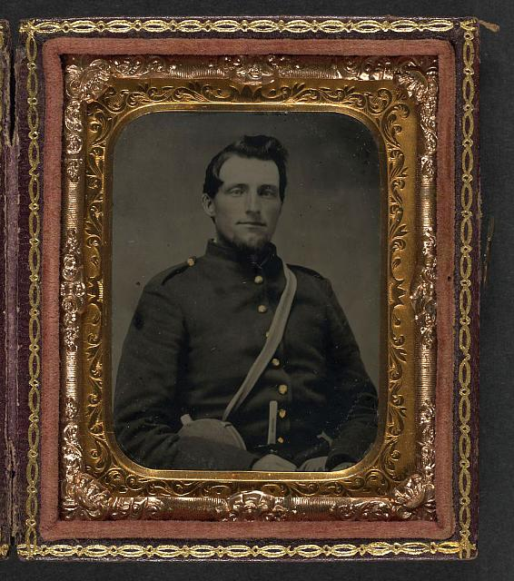 [Unidentified soldier in Confederate uniform with canteen and knife]