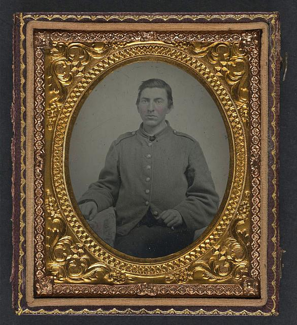 """[Unidentified soldier in Confederate shell jacket with """"I"""" buttons]"""