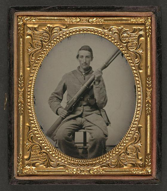 [Unidentified soldier in Confederate uniform with musket]