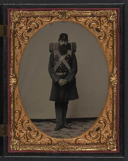 [Unidentified soldier in Union frock coat and Company C, 71st Regiment forage cap with knapsack and bedroll]
