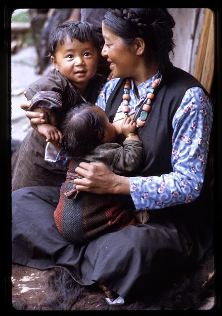 [Nursing mother and children of the Jorbu family, Lachung, Sikkim]
