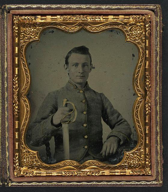 [Unidentified soldier in Confederate cavalry uniform with saber]