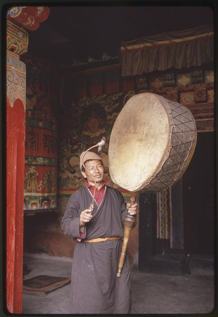 [Monk playing large drum in monastery, Lachung?, Sikkim]