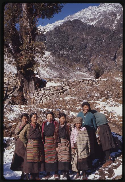 [Group of women standing near stone wall, Lachung, Sikkim]