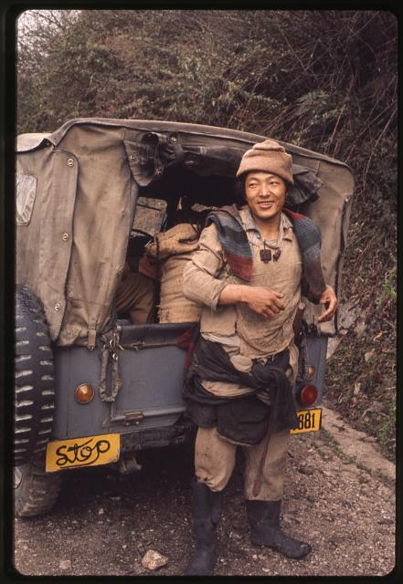 [Man standing behind a small truck, Lachung, Sikkim]