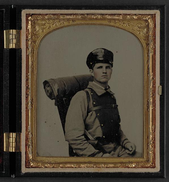 [Unidentified soldier in Confederate uniform of the 11th Virginia regiment with knapsack and bedroll]