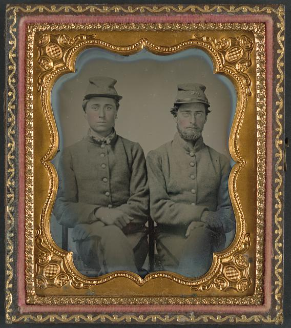 [Two unidentified soldiers in Confederate uniforms and hats marked W.G.]