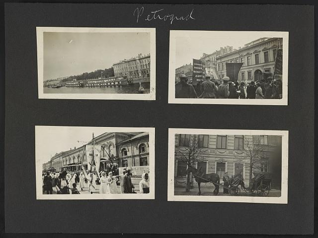 Petrograd. [Boats along the side of the Neva River. People carrying banners. Women carrying a religious banner. Horse and carriage]